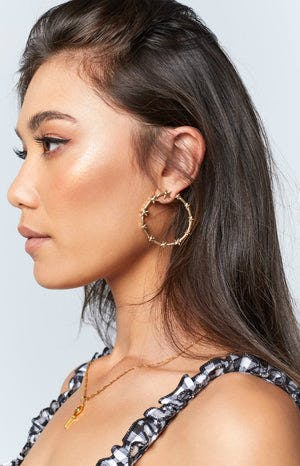 Eclat Sole Star Earrings Gold